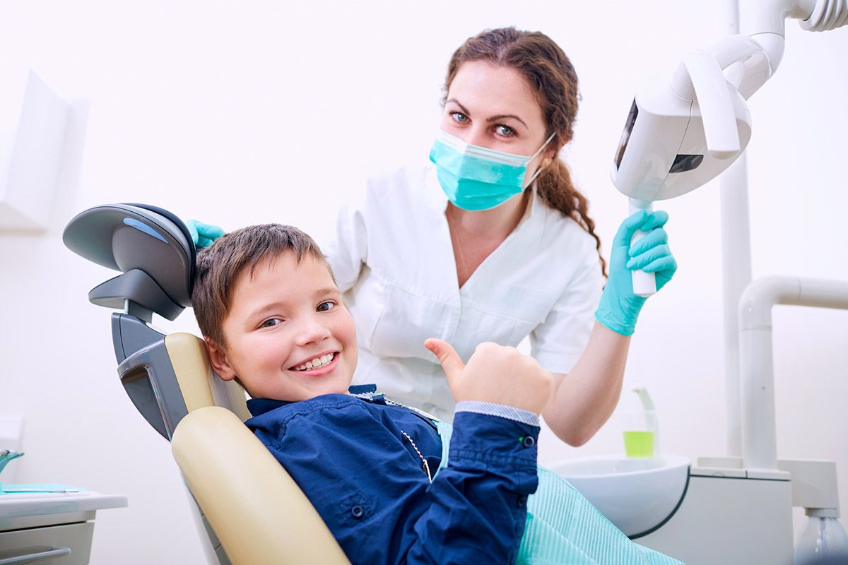 Kid with the dentist